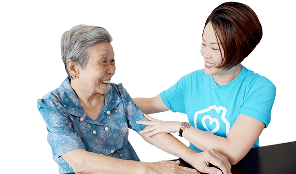 Homage caregiver speaking to and caring for an elderly woman