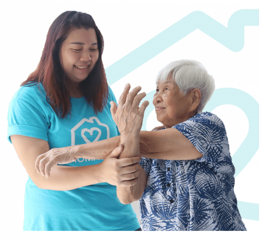 Homage Caregiver helping an elderly woman stay active with simple arm exercises, with the Homage logo in the background